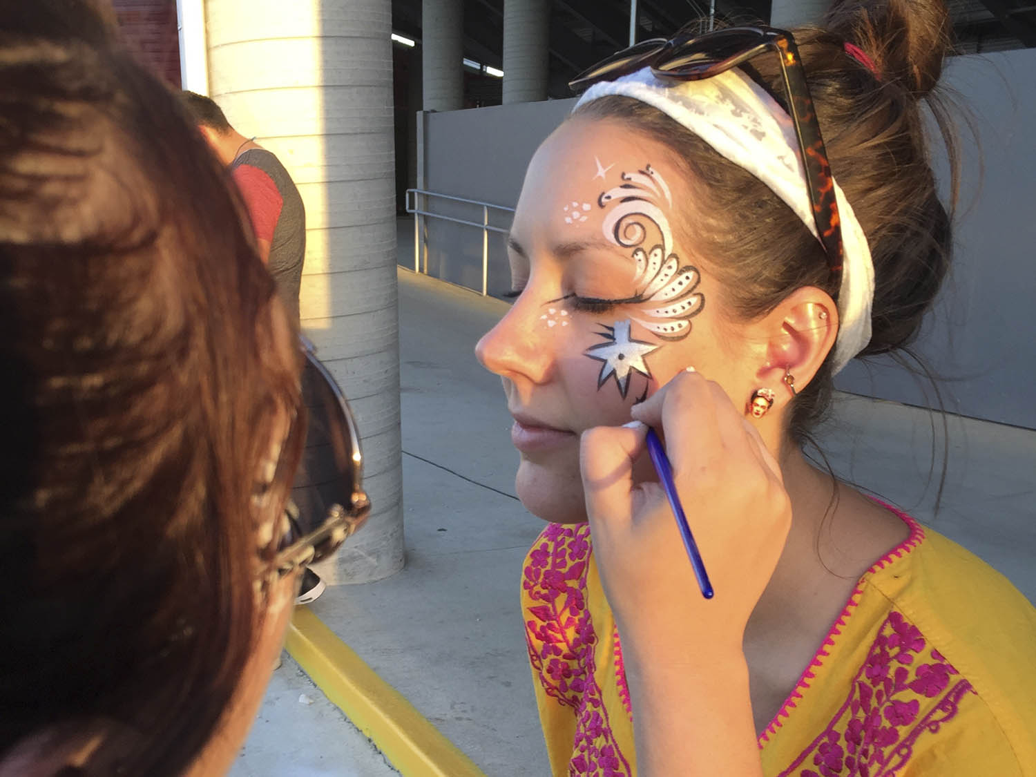 Artist applying custom face paint.